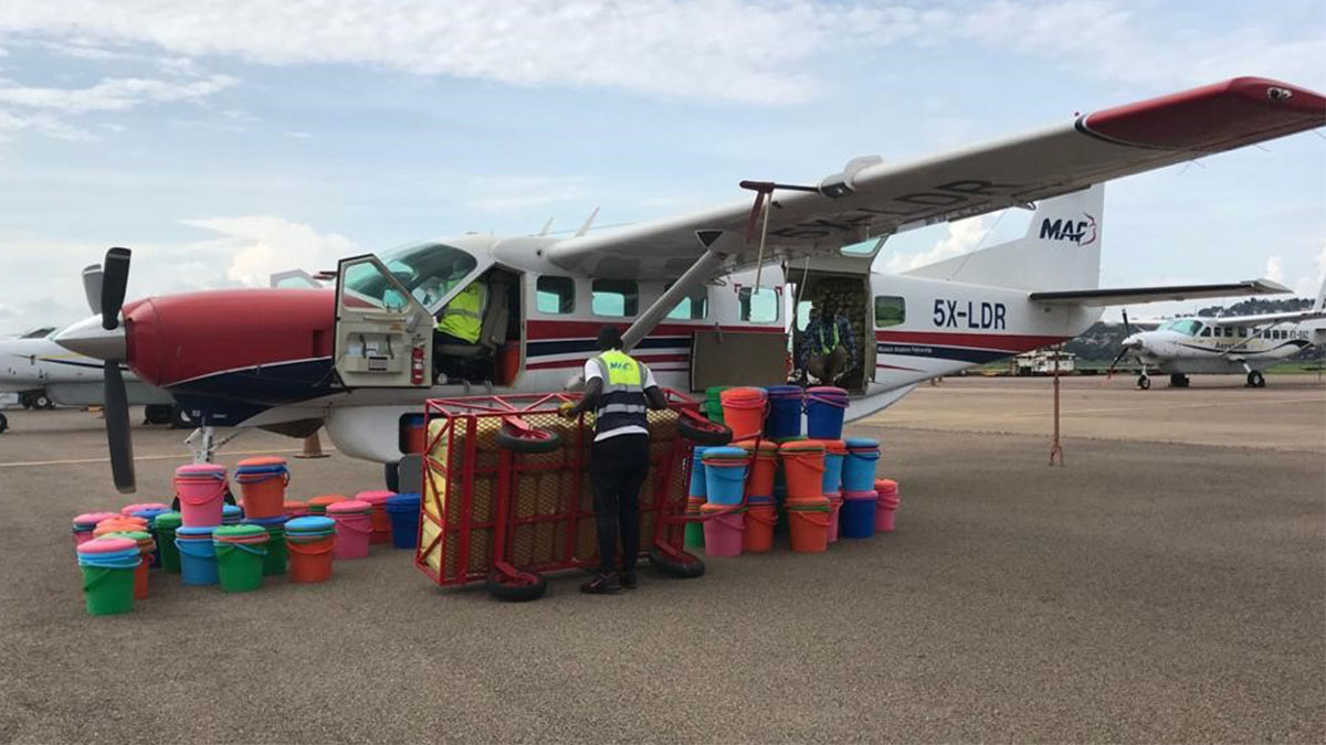 First breakthrough emergency flight bound for Kasese District - cargo includes buckets