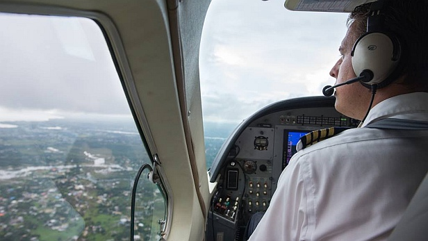 MAF pilot Aarjan Paas flies over flooded community in Liberia
