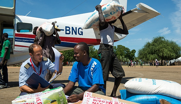 Unloading aid supplies from the MAF aircraft in South Sudan