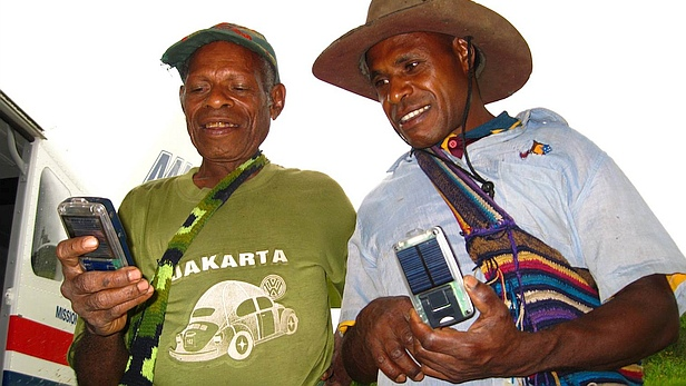 Two men with solar Bibles | MAF