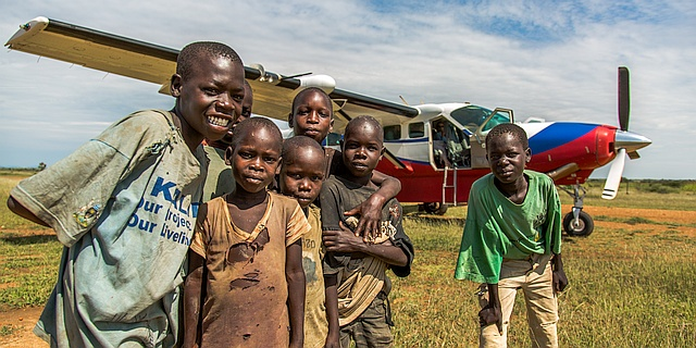 MAF plane and children in Uganda