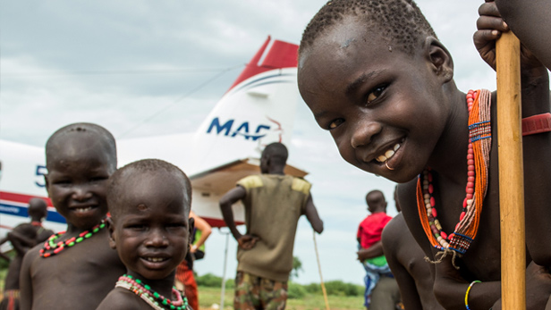 Three boys at the Holy Trinity Peace Village in the Kuron region of South Sudan.