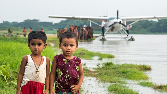 MAF's amphibious Caravan and children in Bangladesh