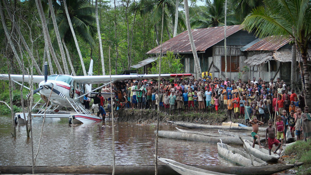 The Hupla people greet the arrival of an MAF plane carrying the Bible in their native language.