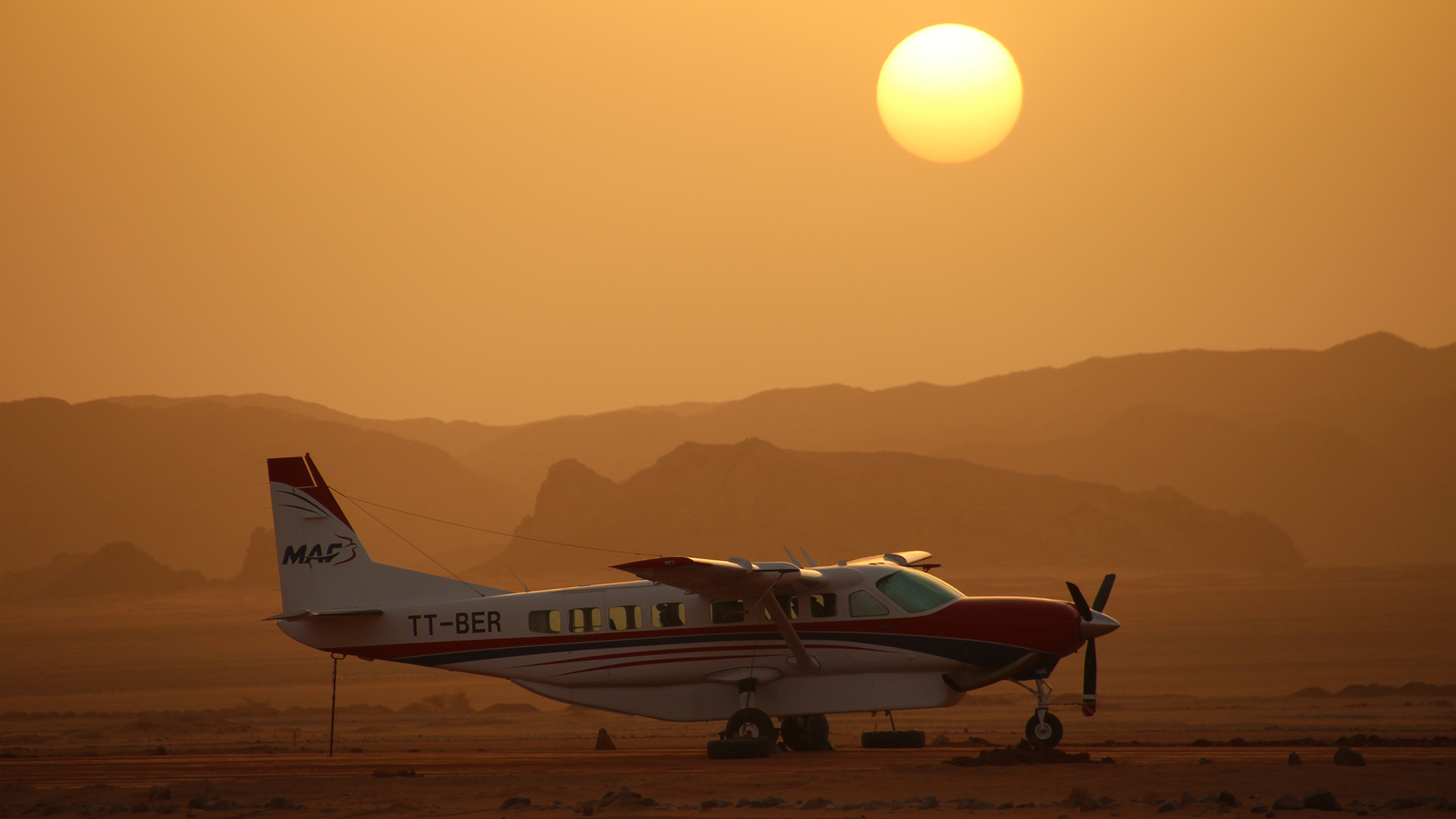 MAF plane grounded at sunset in Africa