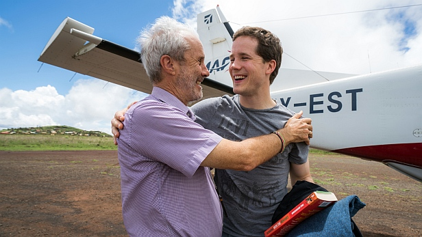 Robert Martin greets son Simon as he arrives at Marsabit on MAF Kenya's shuttle to attend the ceremony for the retirement of Rev Robert Martin (the first Bishop of Marsabit Diocese) and the consecration of the new bishop, Qampicha Daniel Wario. MAF aircraft