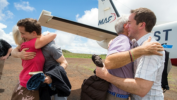 Robert and Sue Martin greet sons Simon and Andrew as they arrive at Marsabit on MAF Kenya's shuttle to attend the ceremony for the retirement of Rev Robert Martin (the first Bishop of Marsabit Diocese) and the consecration of the new bishop, Qampicha Daniel Wario. MAF aircraft
