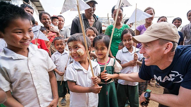 MAF's Myanmar Country Director Chad Tilley with children in Leilenpi