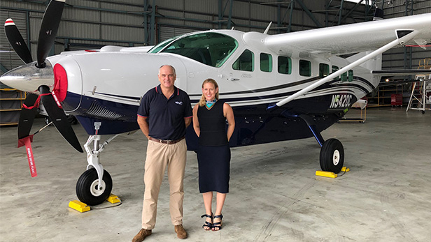 William Nicol, aviation director, Mission Aviation Fellowship with Kate Hamilton, regional sales director, Textron Aviation in front of a Grand Caravan EX