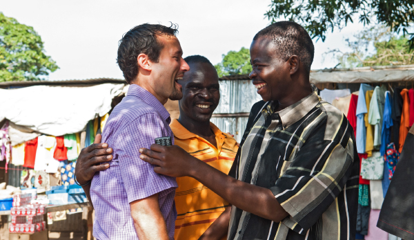 Friends greet each other in Mundri, South Sudan