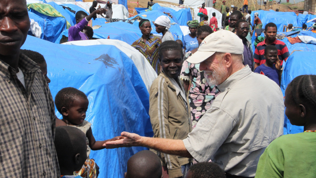 John Cadd of MAF visits a refugee camp in Bunia, eastern DRC, in March 2018. Photo by Ashley Petersen.
