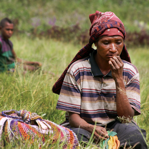 A Papua New Guinean man sits in thought