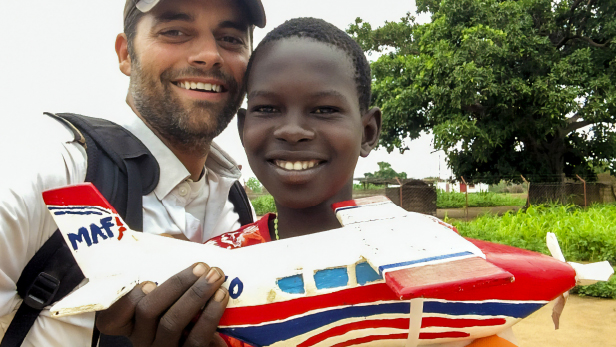 MAF Pilot Dave Forney with a South Sudanese boy in Uganda