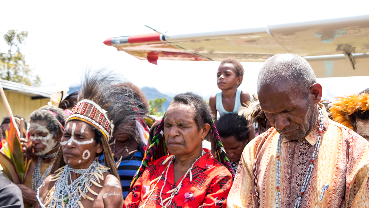 The Yali tribes gather together to pray in Apahapsili, Papua, Indonesia
