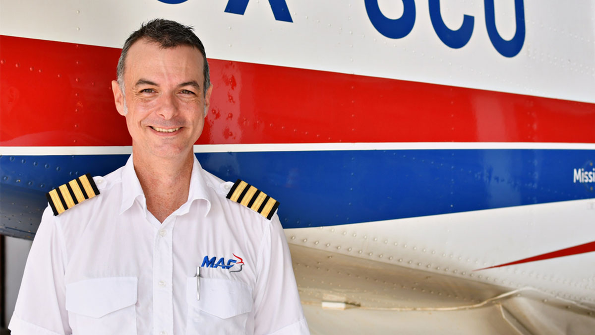 MAF Pilot, Steven Biggs, standing in front of aircraft in Monrovia before coronavirus hit
