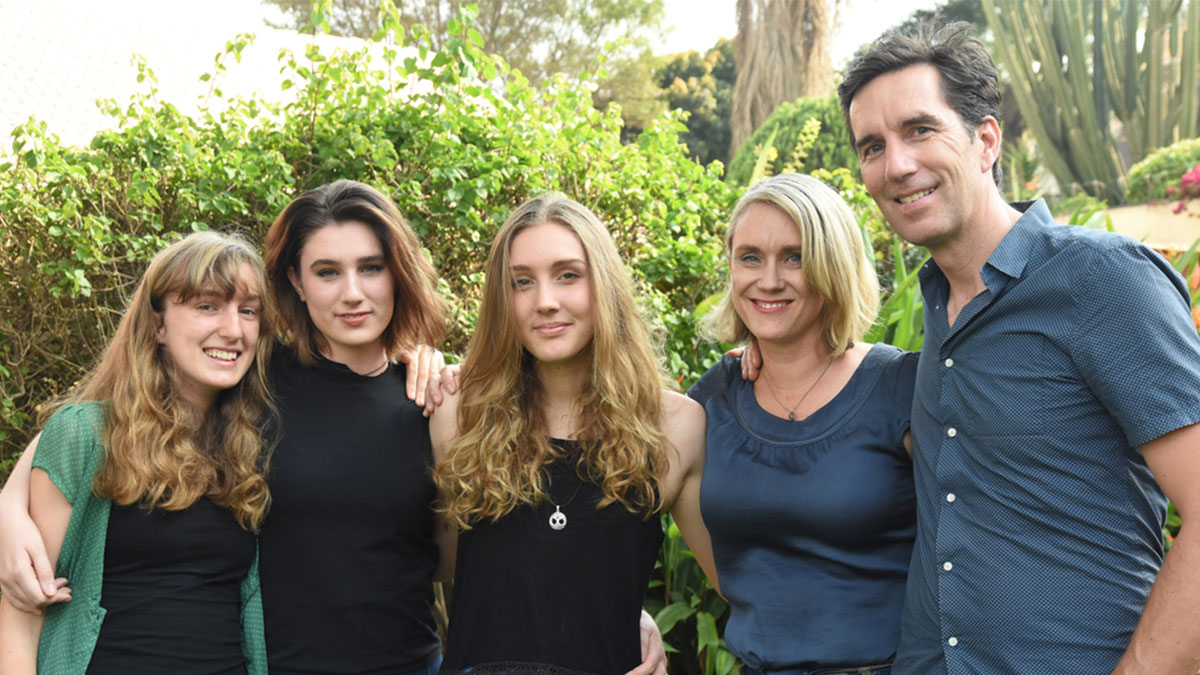 Jill and Greg Vine (R) with their three daughters (L)