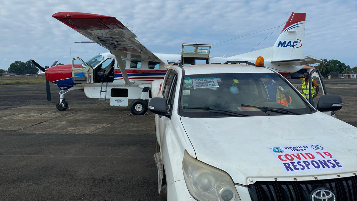 MAF aircraft piloted by Steven Biggs behind Liberia's Ministry of Health car
