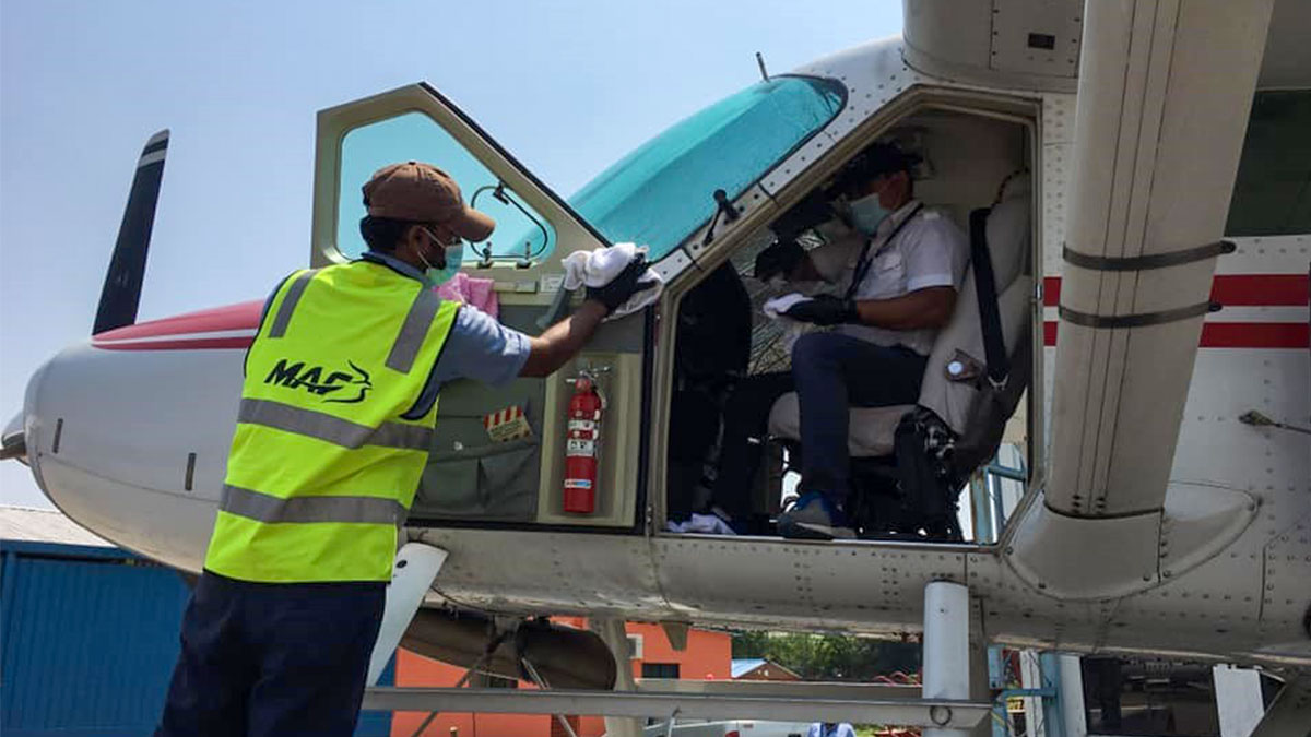 MAF worker cleaning plane as part of new coronavirus preparations in Bangladesh