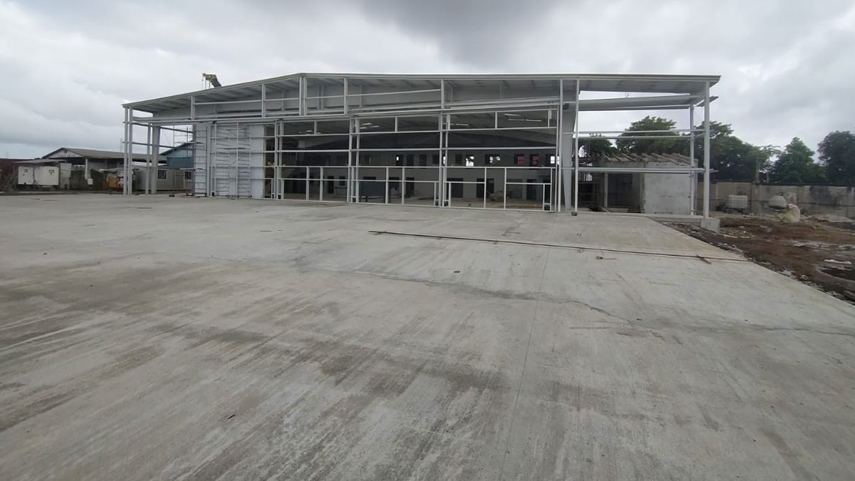 Outside of hangar and the apron where aircraft will be loaded and boarded.