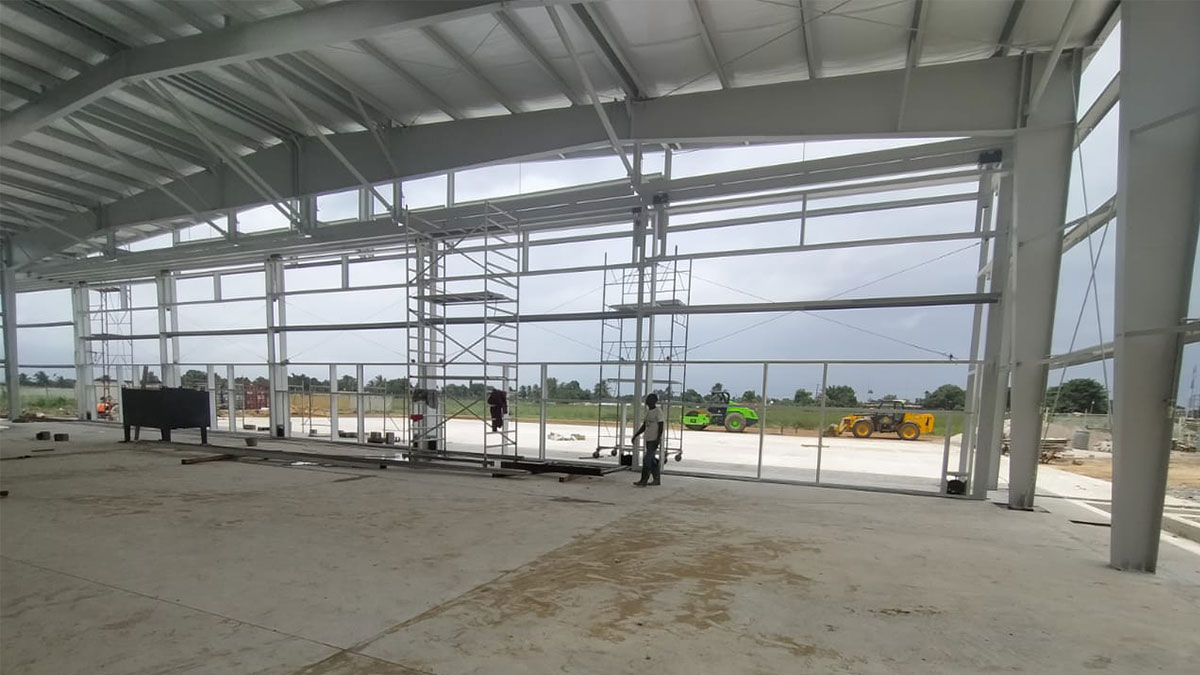Inside the new empty hangar frame in Monrovia, which will house two MAF aircraft