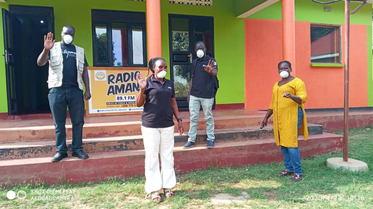 Four Tutapona staff outside Adjumani Community Radio Station