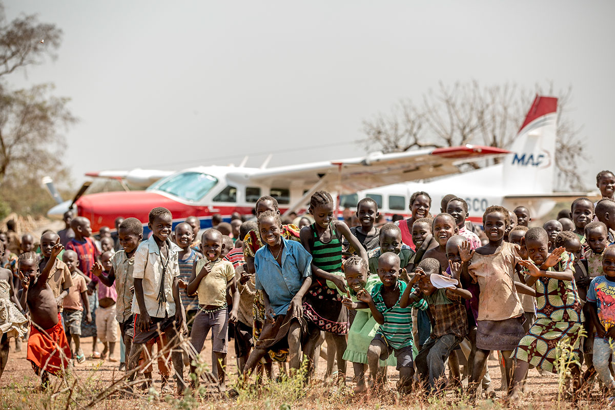 Crowds gather to greet the MAF plane in Mvolo, South Sudan.