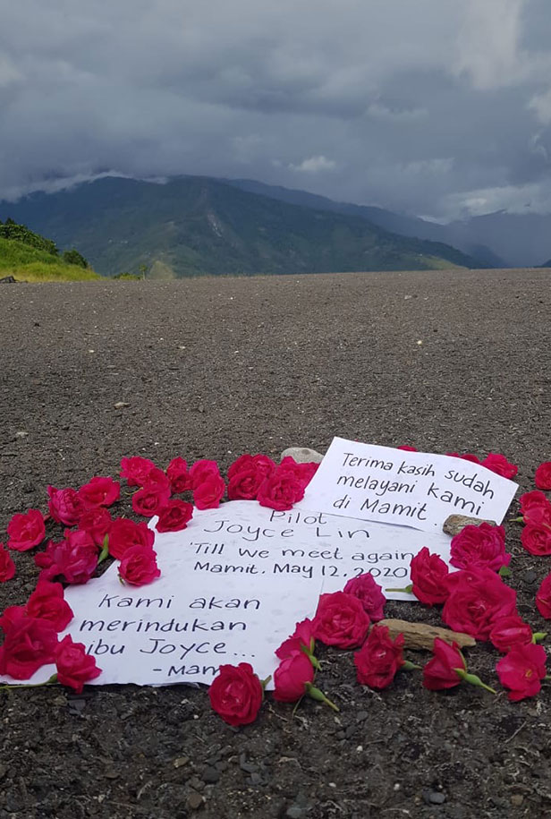 A memorial of roses on the runway of Mamit Village, Papua marks the spot where Joyce was scheduled to land