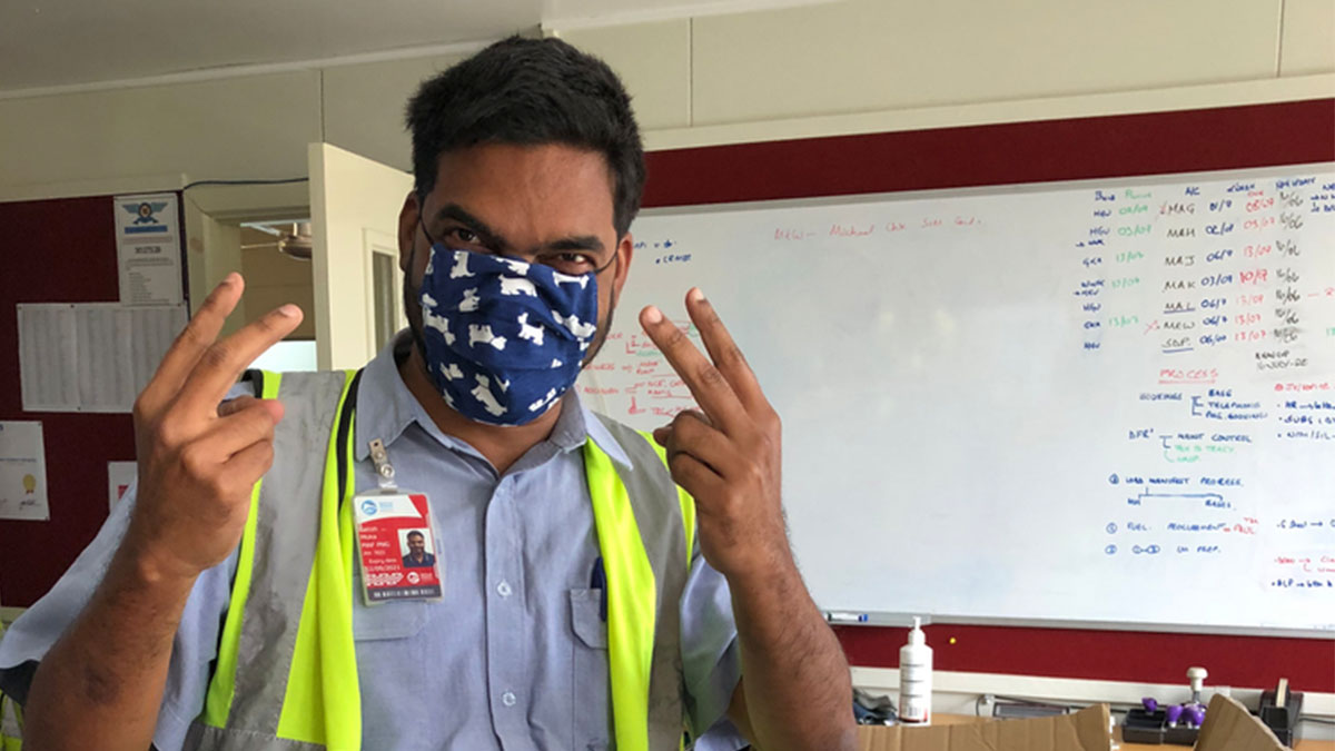 MAF Pilot, Satish Moka, wearing a home-made supporter mask at the Mount Hagen Operations Centre in PNG