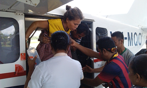 MAF's 700th air ambulance patient is helped out of the plans