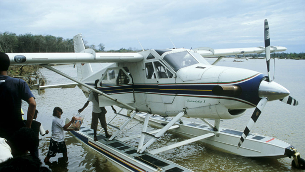 Vital supplies are unloaded from the Beaver Floatplane in PanangSape.