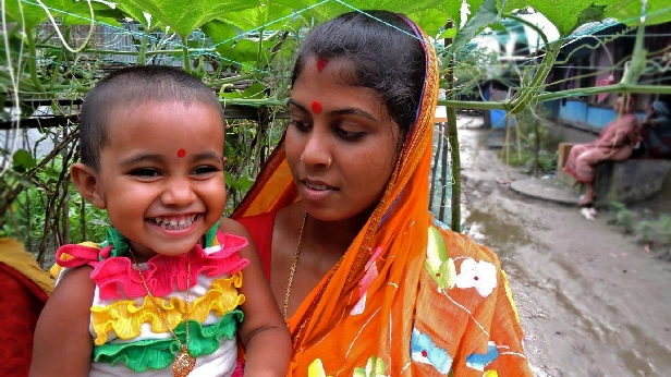 Aporna Shikder with her daughter. Aporna received training in Bangladesh at the USAID-sponsored Farmer Nutrition School