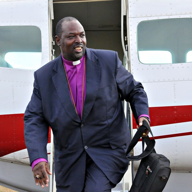 Archbishop Jackson as he exits the MAF plane in Olorte