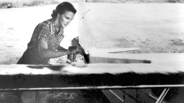 MAF pilot Betty Greene repairing cloth plane in Sudan. circa 1950