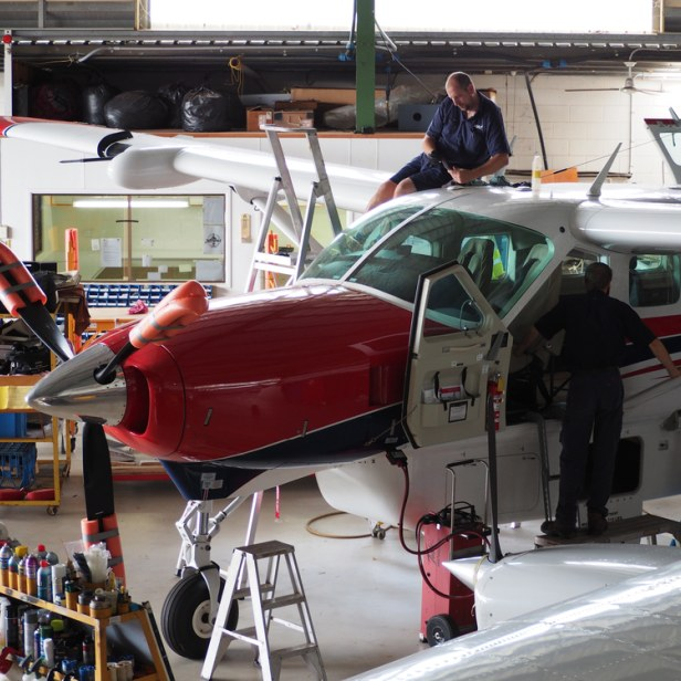 The Mareeba Team performing upgrades on the aircraft