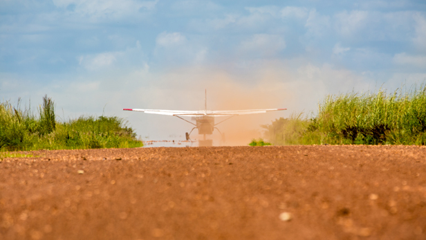The rear view of a Cessna 206 as it takes off.