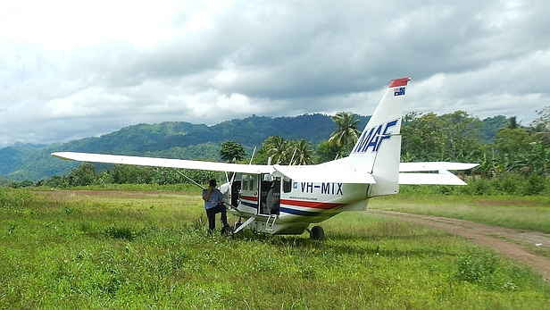 Pilot Michael Bottrell with MAF's GA8 Airvan at Same, south-central Timor-Leste