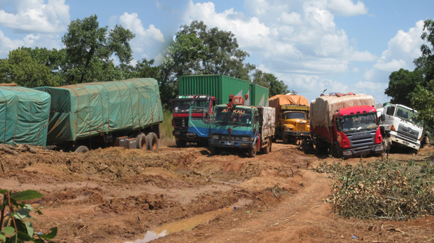 Trucks stuck whilst travelling a muddy road in South Sudan.