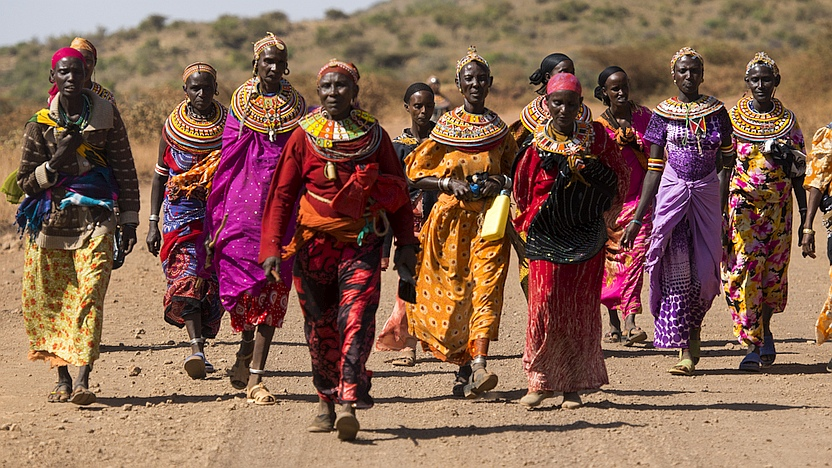 Rendille and Borana Women from the Sauti Moja peace project walk home together near Marsabit, northern Kenya.   Photo: LuAnne Cadd