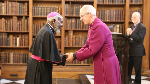 Bishop Taban recieveing award from The Archbishop of Canterbury, Justin Welby