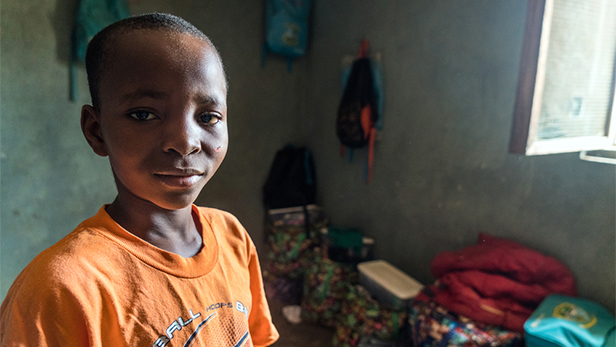 12-yr old Bobo lost his father before Ebola and his mother during the height of the Ebola crisis from a different illness. Image credit - LuAnne Cadd/Copyright MAF