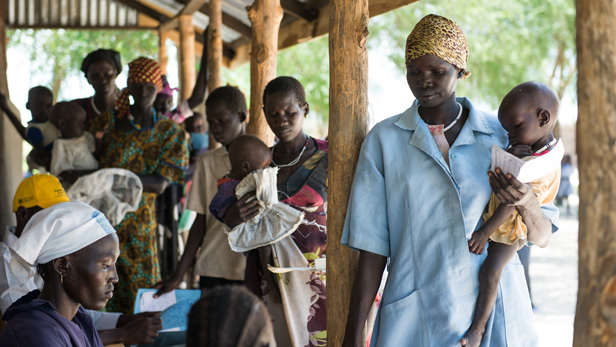 Women line up to receive Plumpy Nut supplement packs for their malnourished babies at the Tearfund feeding center in South Sudan