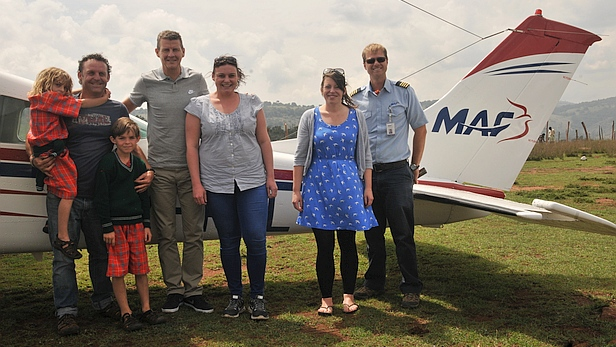 The COCO charity team, Steve Cram and MAF pilot Daniel Loewen-Rudgers with plane at Entesekera, Kenya - MAF