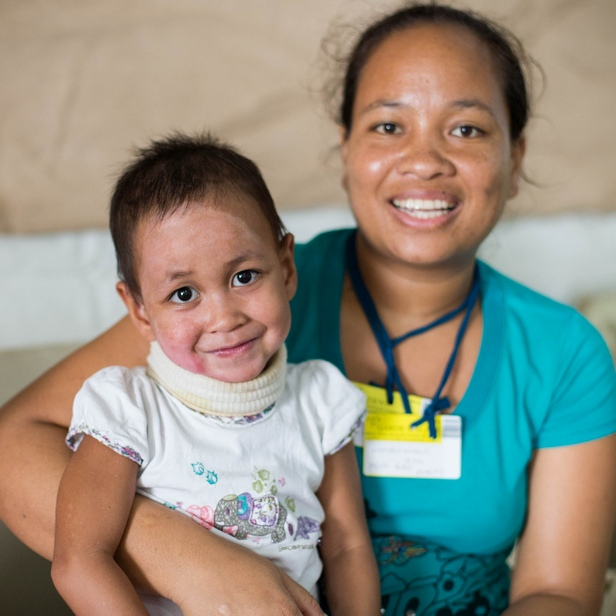 Fitia after an operation due to severe burns. She was flown by MAF aircraft to get medical care at the Mercy Ships hospital. Photo: Josh Callow