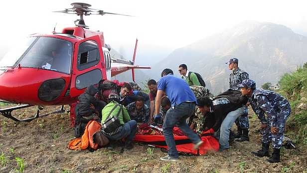Nima is airlifted in Nepal after earthquake wound. Photo credit: CARE