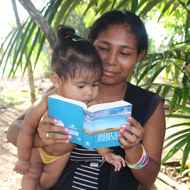 Mother and daughter from the Inanu community engrossed in their Bible.