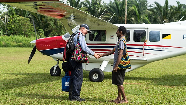 MAF plane and pilot Paul Woodington and Pastor Lawrence in PNG