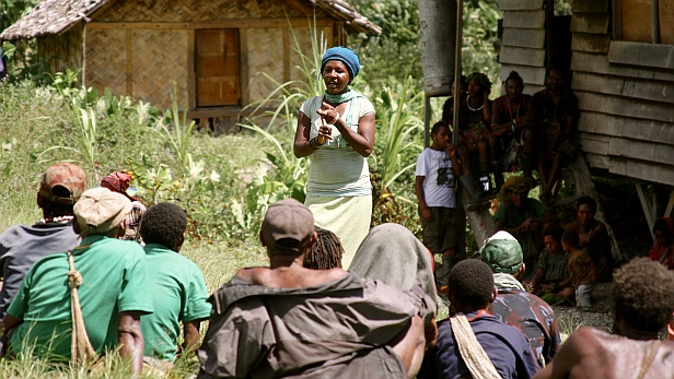 Nes talking to villagers. MAF PNG. Credit: Anton Lutz