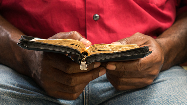 Papua New Guinean man reads his Bible