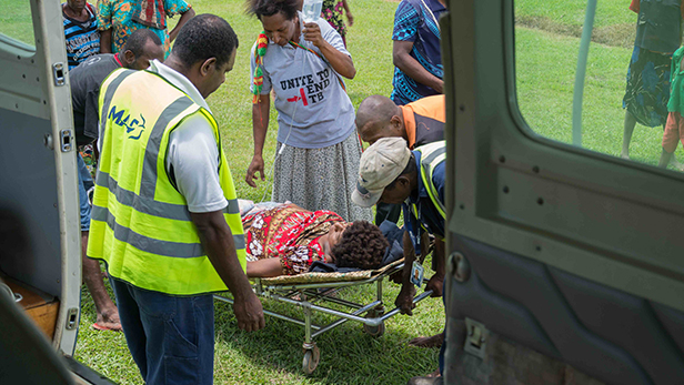 Opepeyato being transferred into the Caravan at Kawito by our Kawito base staff and other willing helpers (RR)