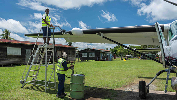 Nawi assisting with refuelling the Caravan at Kawito while waiting for the patient to arrive (RR)
